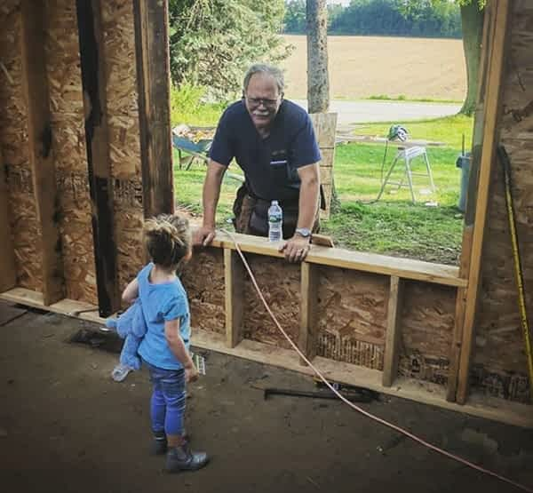 Richard Struck and granddaughter on the job site
